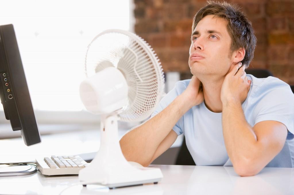 man-sits-in-front-of-fan