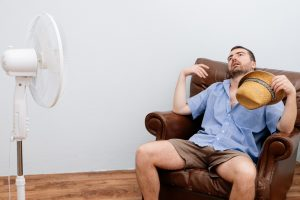 man-overheating-on-couch