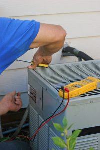 technician-repairing-AC